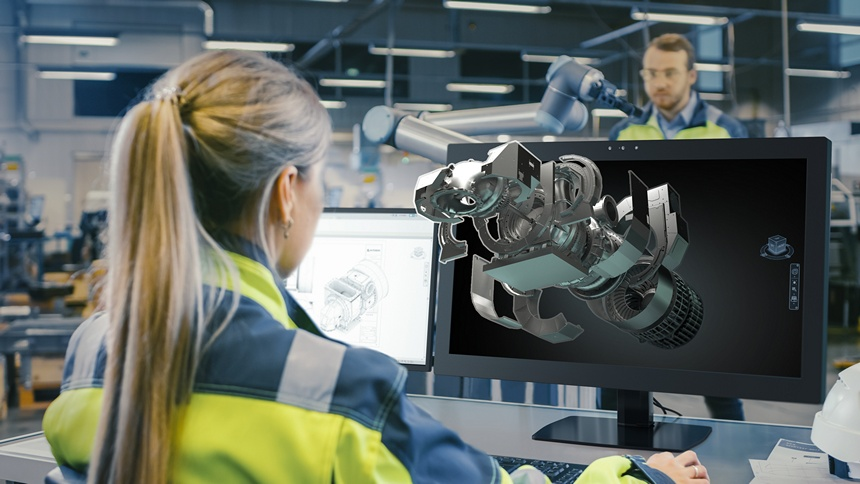 Engineer viewing and editing a 3D CAD model of an engine on the ZVIEW 28-inch AS3D display.